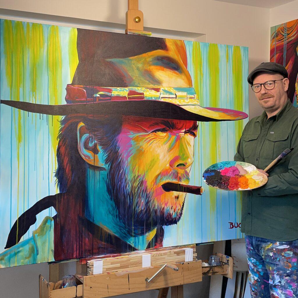 original popart maleri af amerikanske Clint eastwood, med cigar og stetson cowboy hat fra westerfilmen Den gode, den onde og den grusomme med løbende maling, malet af kunstner Allan Buch. Maleri til salg Maleri til salg